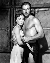 Lex Barker as Tarzan brandishing knife with unidentified actress 8x10 inch photo