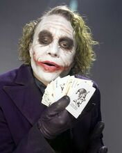 Heath Ledger holds Joker card The Dark Night as The Joker 8x10 inch photo