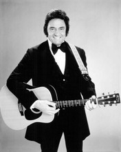Johnny Cash smiling wearing tuxedo & frock coat with guitar 1980's 8x10 photo