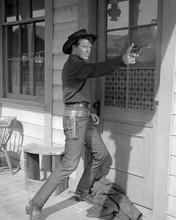 Robert Horton firing gun on porch Wagon Train 8x10 inch photo