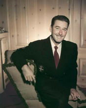 Erroll Flynn looks suave in suit and tie with charasmatic smile 8x10 inch photo