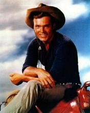 Ty Hardin smiling pose on saddle as Bronco Layne 1958 8x10 inch photo