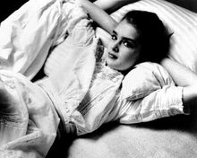 Brooke Shields relaxes back on her pillow in bed 1978 Pretty Baby 8x10 photo