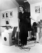 Judy Garland full length pose singing into microphone 8x10 inch photo
