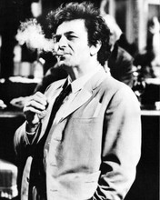 Peter Falk as Columbo in his suit puffing on cigar thoughtful mood 8x10 photo