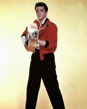 Elvis Presley poses in red jacket with his guitar 8x10 inch photo