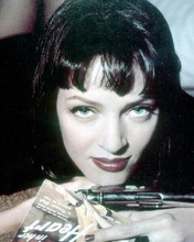 Uma Thurman holds pistol and pulp magazine in pose for Pulp Fiction 8x10 photo