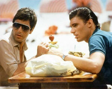 Scarface 1983 Steven Bauer Al Pacino sit having drinks outdoors 8x10 inch photo