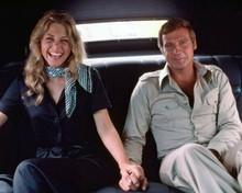 Six Million Dollar Man Lindsay Wagner & Lee Majors hold hands in car 8x10 photo