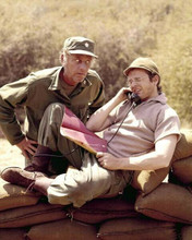 M.A.S.H. Mclean Stevenson Gary Burghoff sits on sandbags on phone 8x10 photo