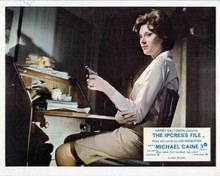 The Ipcress File 8x10 inch photo Sue Lloyd sat at desk pointing gun