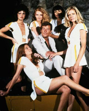 Moonraker Roger Moore poses with Bond girls 8x10 inch photo