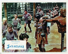 Spartacus 8x10 inch photo Kirk Douglas walks with slaves in arena