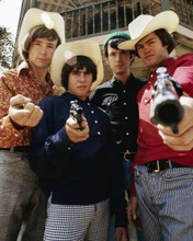 The Monkees Peter Davy Mike & Micky in western hats holding guns 8x10 inch photo