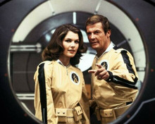 Moonraker lois Chiles & Roger Moore look through space porthole 8x10 inch photo