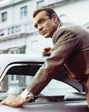 Sean Connery as James Bond leaning on Aston Martin from Goldfinger 8x10 photo
