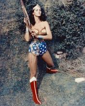 Lynda Carter as Wonder Woman using belt to climb up rock face 8x10 inch photo