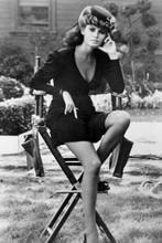 Raquel Welch in short black dress sitting on studio chair 4x6 inch real photo