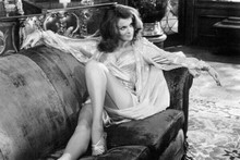 Ann-Margret lies back seductively on sofa showing legs The Cheap Detective 4x6