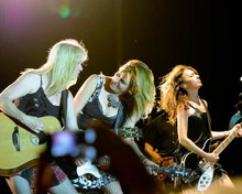 The Bangles 8x10 inch press photo performing on stage playing guitars