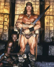 Conan The Destroyer Grace Jones lies at feet of Arnold Schwarzenegger 8x10 photo