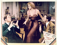 This is an image of Vintage Reproduction Lobby Card of Libeled Lady 296517