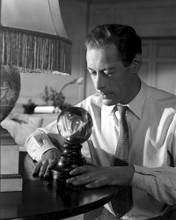 This is an image of Photograph & Poster of Rex Harrison 102701