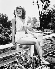 This is an image of 163385 Rita Hayworth Photograph & Poster