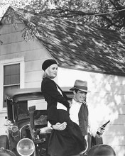 This is an image of 163962 Warren Beatty & Faye Dunaway Photograph & Poster