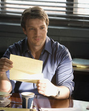 This is an image of 281163 Nathan Fillion Photograph & Poster