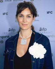 This is an image of 255073 Carrie-Anne Moss Photograph & Poster