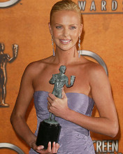 This is an image of 259168 Charlize Theron Photograph & Poster