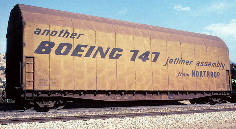 """Southern Pacific Flatcar SP 598329 with """"another Boeing 747 jetliner assembly from NORTHROP"""" Hood - Charles Lange Photo"""