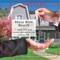 Man in Suit Handing Over Keys Real Estate Lip Balm Tube