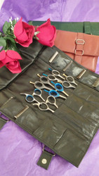 Super soft genuine leather. Designed by Randy nearly 25 years ago, this tri-fold is designed to hold 6 scissors in the center pockets, and 8 blades on the outside pockets.  Features vinyl business card holder as well as a larger outer pocket for combs.  Our design is unique in that the blade pockets are genuine leather.  Watch out for imitations with vinyl blade pockets that can draw moisture to your blades.