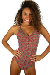 Green Hibiscus crisscross adjustable strap tan through swimsuit.