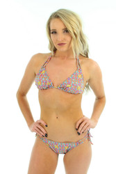 Tan through string bikini bottoms with double tie sides in orange Bubbles print.
