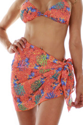 Front view of orange Fiji tan through sarong.