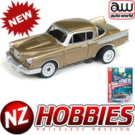 AUTO WORLD THUNDERJET ULTRA G R22 1957 STUDEBAKER HAWK (GOLD) HO SCALE SLOT CAR
