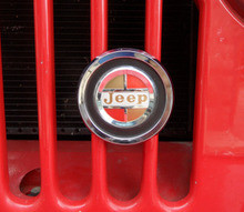 Grill emblem, Reproduction grill emblem. Found on Kaiser era jeeps. Metal casting, chrome plated, raised letters, polished, painted to original colors.  Comes complete with mounting br...