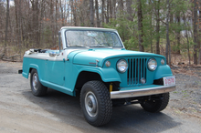 67 jeepster convertible blue and white