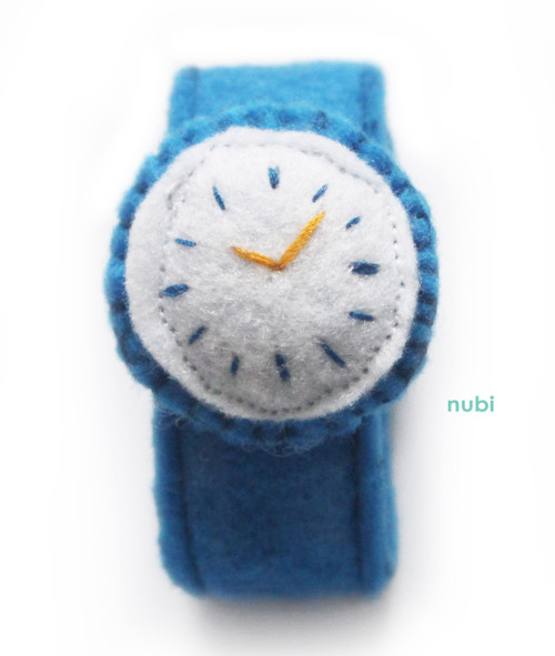 blue felt toy watch