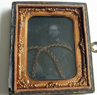 Portrait of Civil War soldier and braided hair (SOLD)