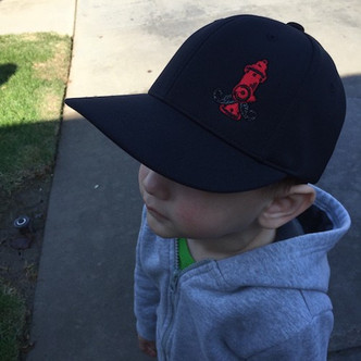 Hat pictured on a 3 year old