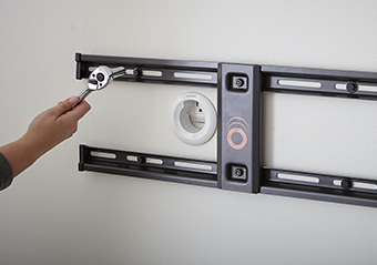 mount the wall plate to wood studs or concrete walls using a drill and rachet