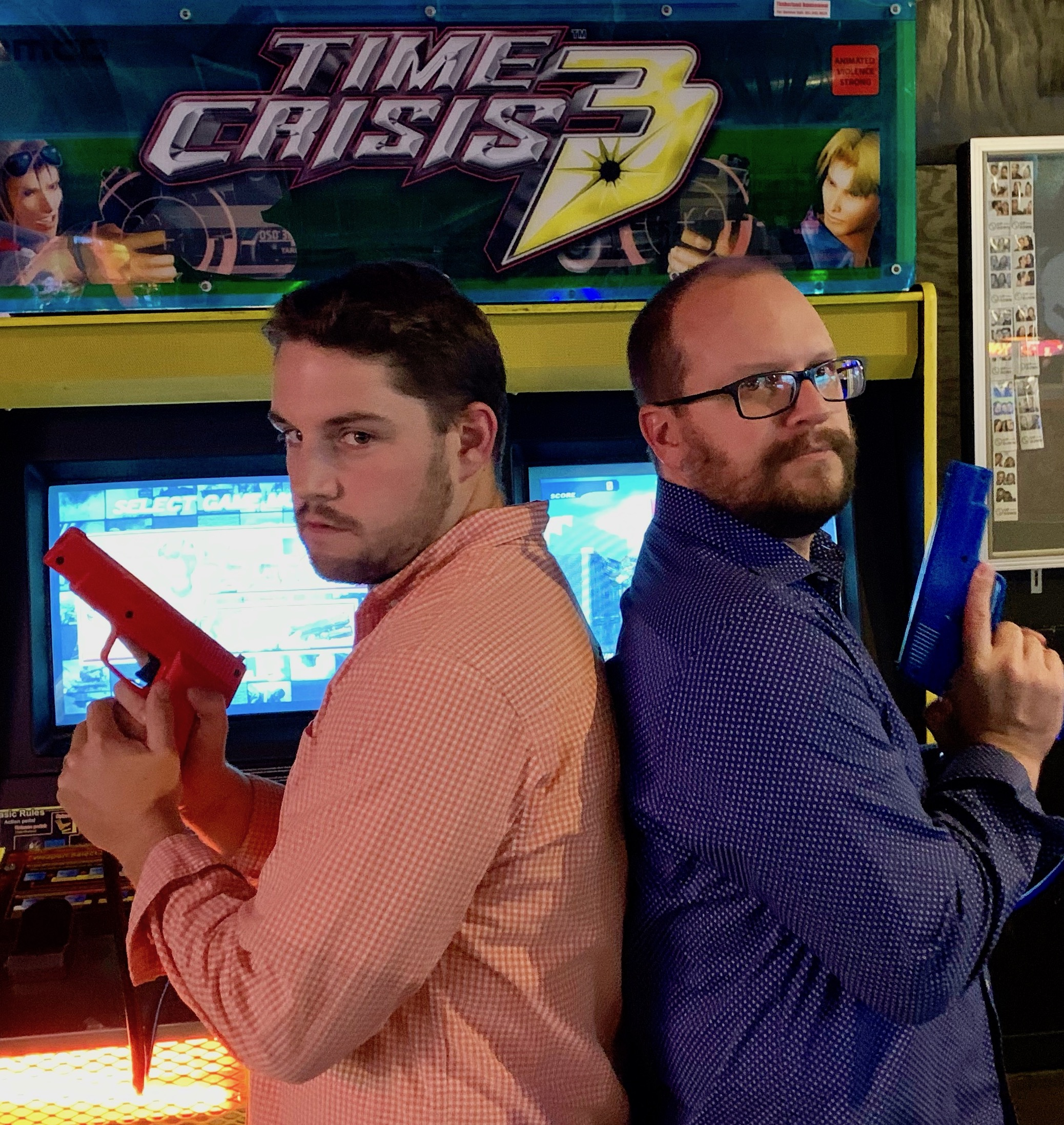 Handsome echogear employees play Time Crisis 3 at Up-Down Minneapolis