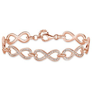 Finely-crafted infinity symbols in feminine 18k rose gold plating unite to create the elegant THE ETERNITY OF LOVE bracelet whose glittering lines of pavé stones in white zirconia lend the symbol of the eternity of love its radiant sparkle.