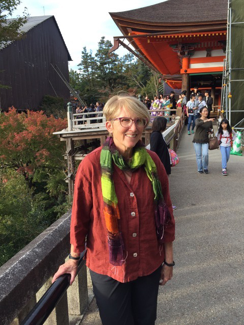 Jane's Paprika Tuxedo Top accessorized with some well-chosen scarves served her well on a recent Japanese trip.