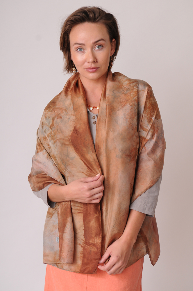 Eucalyptus imparts subtle earth and sky tones, beautifully rendered in this organically dyed silk scarf.