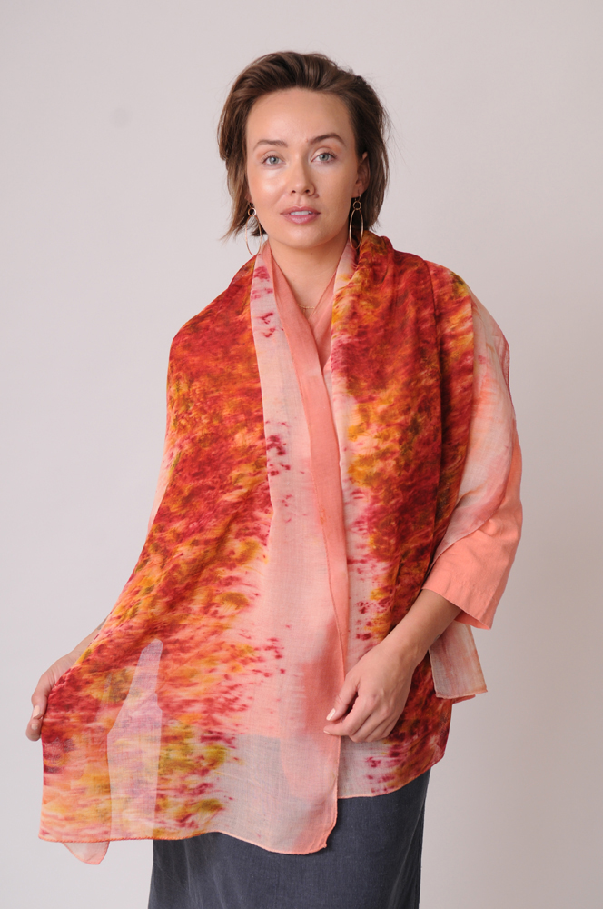 The delicately woven organically dyed wool scarf gets its sunset colors from tree bark and marigolds.